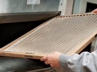 Home owner changing their dirty air filter